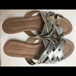 Tahari leather sandals with silver details.